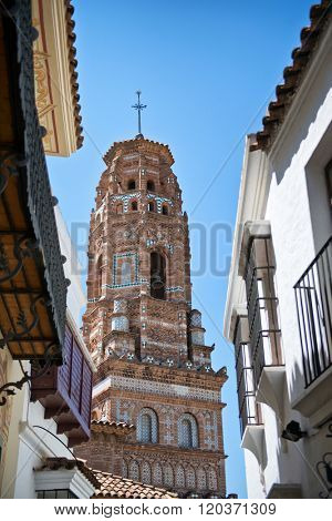 View of Torre de Utebo Framed by Other Buildings, Part of Poble Espanyol Museum in Aragon, Spain