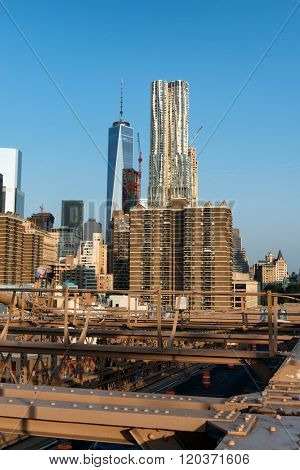 NEW YORK - CIRCA SEPTEMBER 2015: New York City Skyline with Gleaming One World Trade Center Building in Background on Sunny Day with Clear Blue Sky, New York City, New York, USA