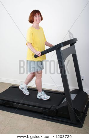 Woman Working Out On Treadmill