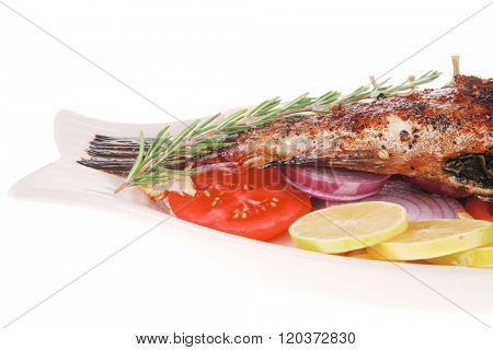 savory: whole fryed sunfish over plate with tomatoes lemons and peppers