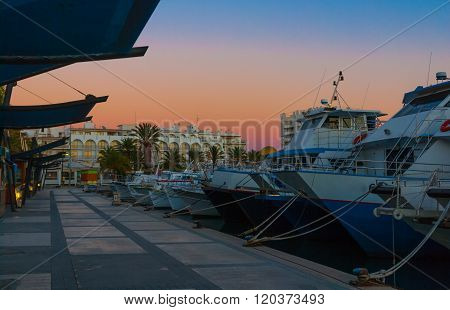 Boats in marina harbor at the end of a warm sunny day in Ibiza, St Antoni de Portmany Balearic Islan