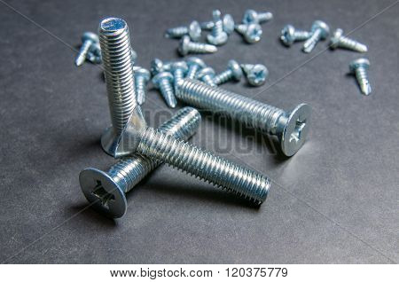 Bolts And Screws On Grey. Left Upright Bolt (right Light)
