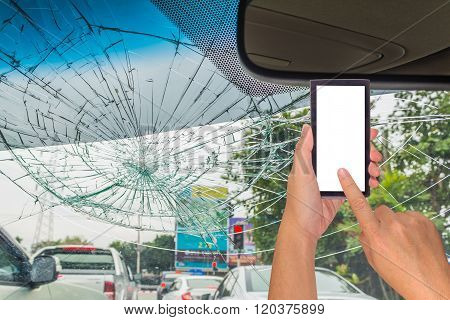 Image Of Male Hand Holding Smart Phone With Blank White Screen And Broken Car Windshield Take Photo