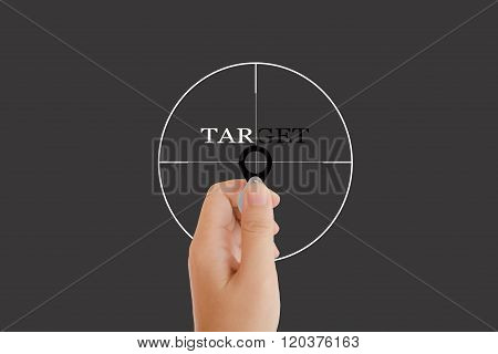 Isolated Hand With Lens And Text Target With Target Sign On Grey Background