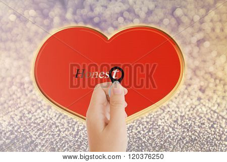 Isolated Hand With Lens And Text Honest With Red Heart Shape On Bokeh