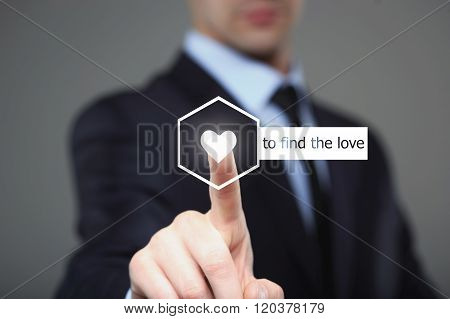 businessman pressing find love button on virtual screens
