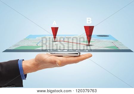 people, technology, navigation and business concept - close up of male hand with smartphone and gps navigator map projection