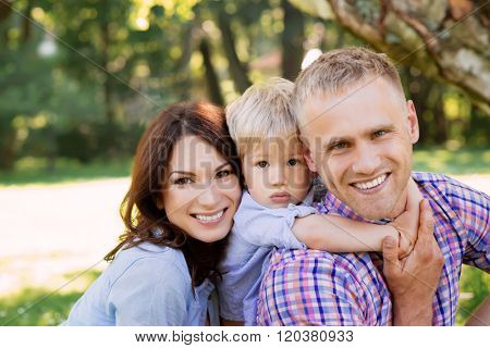 Close-up of happy family spending time together in the park.
