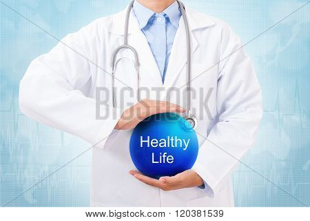 Doctor holding blue crystal ball with Healthy Life sign