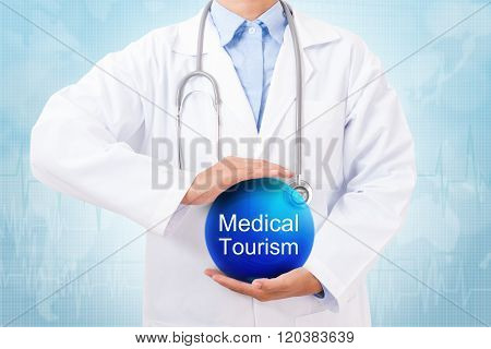 Doctor holding blue crystal ball with medical tourism sign