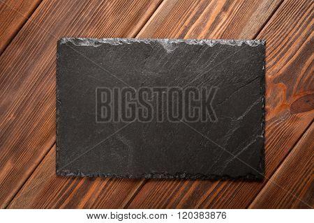 Slate board on old wood
