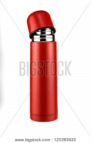 bright red thermos parted on a white background