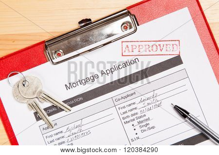 Approved mortgage application form close-up photo