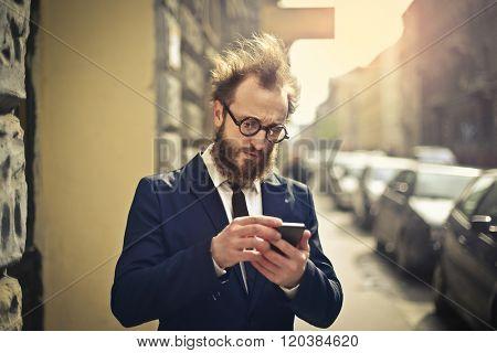 Businessman checking his phone