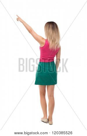 Back view of  pointing woman. beautiful girl. Rear view people collection.  backside view of person.  Isolated over white background. blonde in a green skirt and red sweater saw something interesting