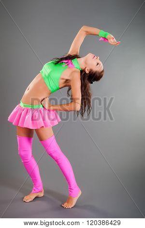 Slim Girl In Dance Costume Poses Bends Body Backward