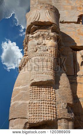 Persian Lamassu Figure From Ancient Persepolis Of Iran Against Blue Sky