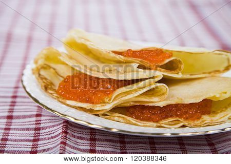 Delicious Pancakes With Red Caviar On A Table