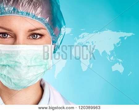 Woman surgeon in mask