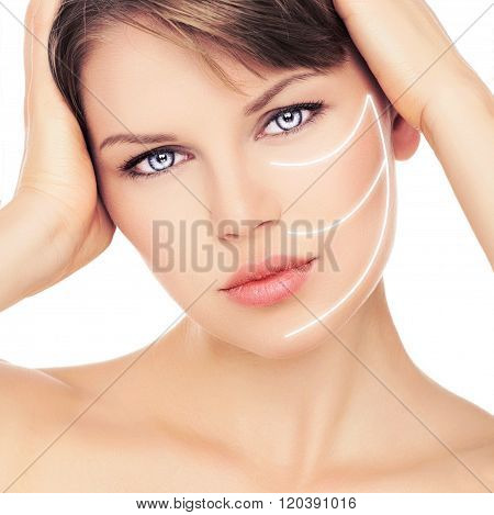 Close-up of beautiful female with laser lines on her face. Facial therapy concept.