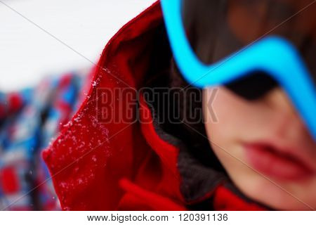 Portrait of little boy with ski outfit blured