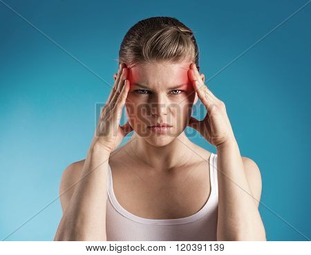 Stressed female having migraine shown with red spots.