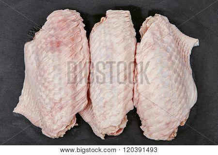Fresh Turkey Wingette On A Black Stone Tray