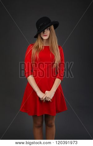 Girl In Red Dress And Black Hat.