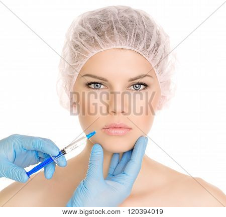 Cosmetic injection in lips zone on woman's face, isolated