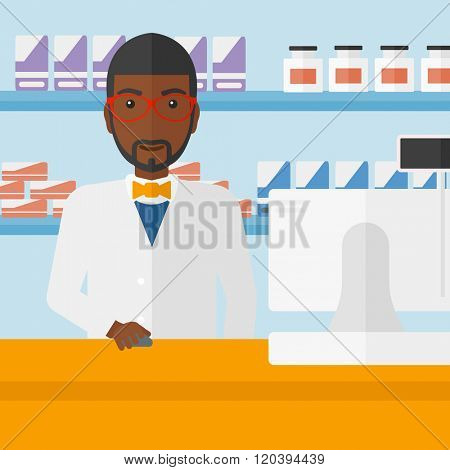 Pharmacist at counter with cash box.