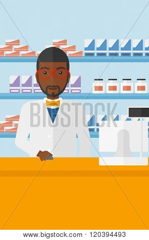 Pharmacist at counter with computer monitor.