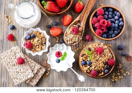 Fresh Healthy Breakfast With Granola And Berries, Wooden Background