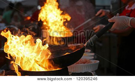 Flambe Chef Cooking In Outdoor Kitchen