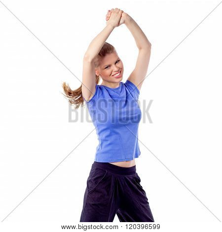 Cheerful happy woman dancing zumba dance with arms raised