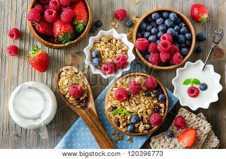 Fresh Healthy Breakfast With Muesli And Berries, Vitamins, Wooden Background
