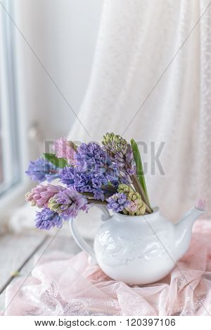 White Teapot With Bouquet Of Hyacinth