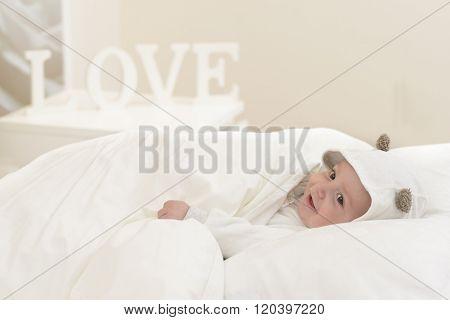 Happy Baby In Bed