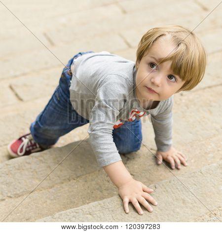 Kid Climbing On Stairs