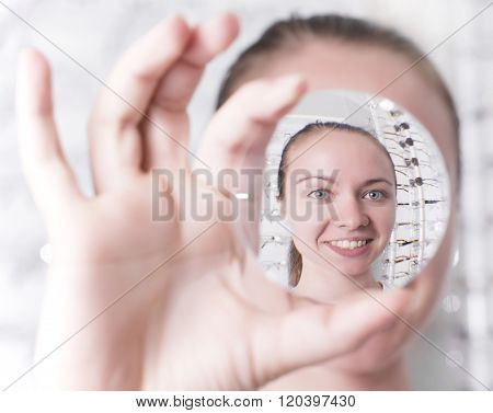 Woman Looking Through A Lens