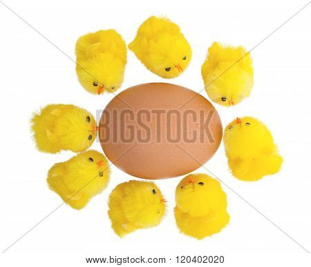 Easter Chicks Surrounding A Large Egg