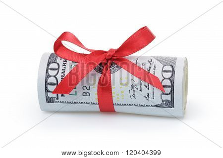 us dollars rolled and tied with red ribbon