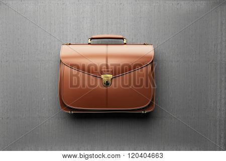 Closeup of fashionable leather briefcase  on the background of gray concrete wall