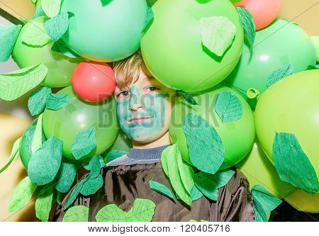 Little School Boy Wearing Costume Made Out Of Ballons And Leaves For Maskenball