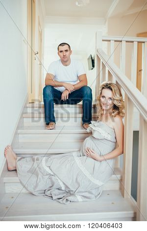 A Happy  http://www.bigstockphoto.com/ru/account/uploads/contribute?editPregnant Woman With Husband.