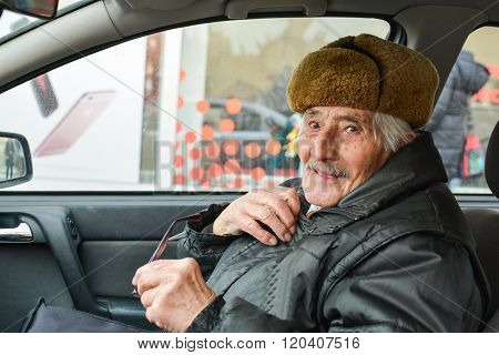 Vital Elderly Man In A Car