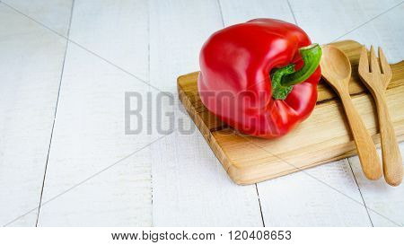 Fresh vegetables sweet Red Peppers on board place on white wooden