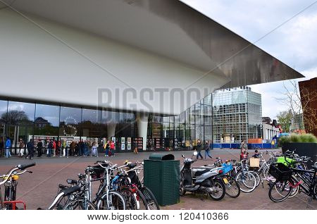 Amsterdam, Netherlands - May 6, 2015: People Visit Stedelijk Museum In Amsterdam