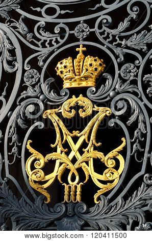 Golden Russian imperial family crown on Hermitage gates.