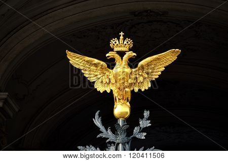 Golden Russian two-headed eagle on black background. Symbol of Russia.