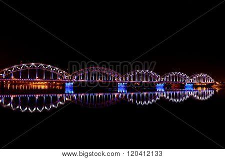 Night Riga panorama with Railway bridge.